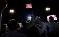 Gov. Mitt Romney takes the stage during a rally in Defiance, Ohio during his 2012 presidential campaign.