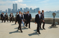 The World Trade Center Twin Towers dominate the New York skyline as President George W. Bush arrives at Ellis Island Tuesday, July 10, 2001, to deliver remarks at an Immigration and Naturalization Ceremony.