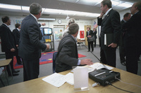 President George W. Bush watches television coverage of the attacks on the World Trade Center Tuesday, Sept. 11, 2001, as he is briefed in a classroom at Emma E. Booker Elementary School in Sarasota, Florida.