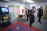 President George W. Bush takes notes as he listens to news coverage of the World Trade Center terrorist attacks Tuesday, Sept. 11, 2001, during a visit to Emma E. Booker Elementary School in Sarasota, Florida.