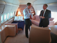 President George W. Bush confers with White House Chief of Staff Andy Card Tuesday, Sept. 11, 2001, in the President's stateroom aboard Air Force One.