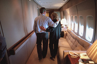 President George W. Bush comforts White House Staff Secretary Harriet Miers aboard Air Force One Tuesday, Sept. 11, 2001.