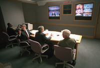 President George W. Bush, is joined by White House Chief of Staff Andy Card, left, and Admiral Richard Mies conduct a video teleconference Tuesday Sept. 11, 2001, at Barksdale Air Force Base in Louisiana.