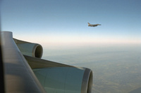 An F-16 escorts Air Force One Tuesday, Sept. 11, 2001, from Offutt Air Force Base in Nebraska to Andrews Air Force Base.