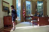 National Security Advisor Dr. Condoleezza Rice watches morning sunrise of Wednesday, Sept. 12, 2001, as President George W. Bush talks with British Prime Minister Tony Blair from the Oval Office.