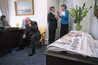 Vice President Dick Cheney talks on the telephone Wednesday, Sept. 12, 2001, while Andy Card talks with Karen Hughes in the Outer Oval Office of the White House.