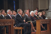 President George W. Bush grasps the hand of his father, former President George H. W. Bush, Friday, Sept. 14, 2001, after speaking at the service for America's National Day of Prayer and Remembrance at the National Cathedral in Washington, D.C.