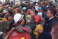 President George W. Bush greets firefighters and rescue workers at Ground Zero Friday, Sept. 14, 2001.