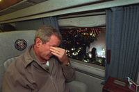 With smoke still billowing from the World Trade Center disaster site out the window, President George W. Bush departs New York City en route to Washington, D.C. aboard Marine One on Sept. 14, 2001.