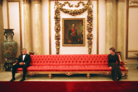 President George W. Bush and Mrs. Laura Bush playfully sit on either ends of a couch prior to a social event at Buckingham Palace. Nov. 20, 2003.