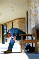 President George W. Bush discovers his dog Barney sitting under his bench. Crawford, Texas, March 6, 2004.